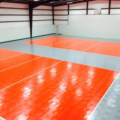 Cancha de voleibol 50-50 gris y roja